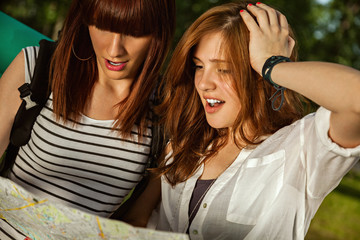 Two Tourist Girls Using Map