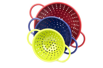 Set of three colorful colanders