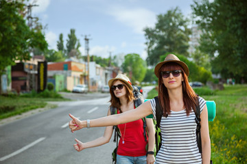 Two Tourist Girls Hitchhiking