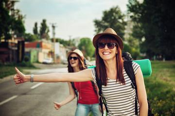 Two Tourist Girl Hitchhiking