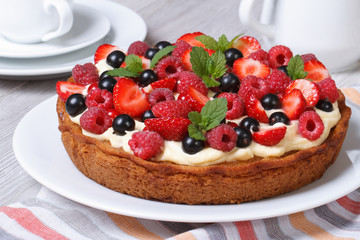fresh berry tart with strawberries, raspberries and mint closeup
