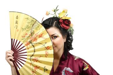 Kimono woman hiding her face behind a fan