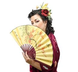 Caucasian kimono woman holding traditional fan