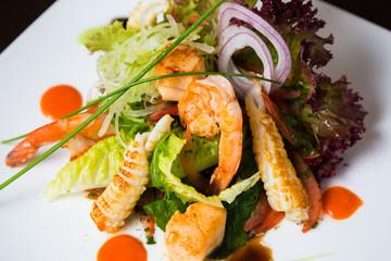 Fresh salad leaves with shrimp