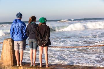 Teenager Girls Boy Pool Watching Ocean Waves