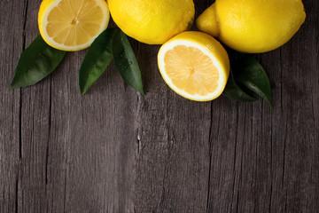 Lemons on wooden background