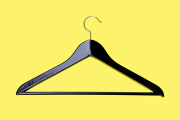 Hanger - a coat hanger for clothes, from an ebony isolated on a