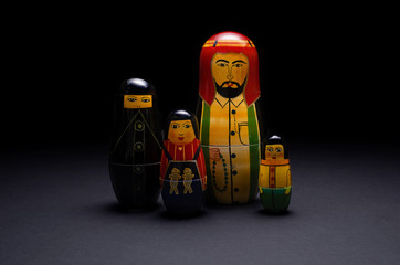 A family of wooden arabic dolls -  black background