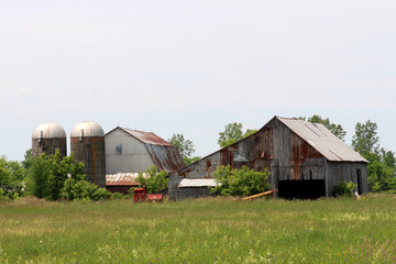 Farm with field in the foreground
