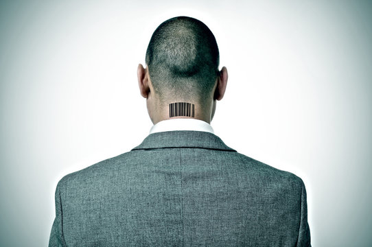 businessman with a barcode in his nape