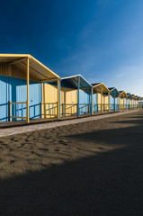 Colored cabins on the beach