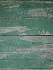 Grün gestrichene Holzbretter