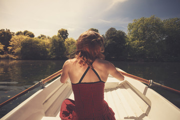Rear view of woman rowing a boat
