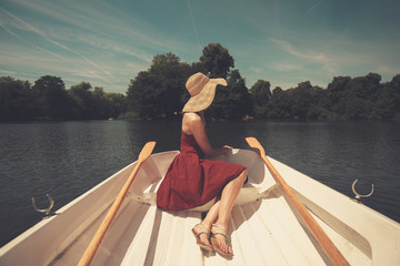 Woman in rowing boat looking at lake