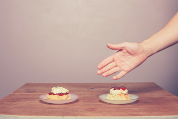 Hand serving cream tea