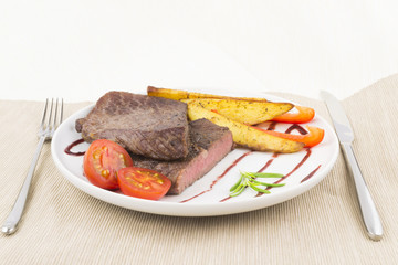 Beef steak with vegetables and cutlery