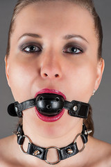 portrait of a woman gagged in the image a slave