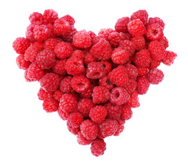 Red raspberries heart shape isolated.