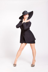 pin-up girl with a big black hat