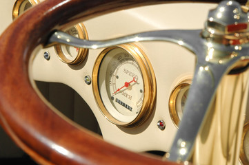 Wall Mural - speedometer dial and steering wheel on a retro auto
