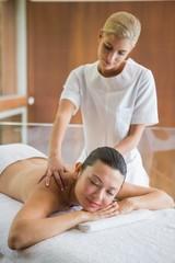 Brunette enjoying a peaceful massage