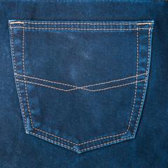 fragment of back pocket blue jeans, background