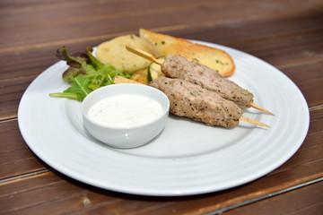 Kebab with grilled vegetables, baguette and yogurt dip