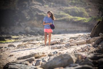 Woman Walks Alone on a Deserted Beach