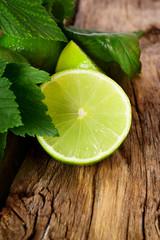 Limes. On wooden board.