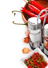 Salt, pepper and garlic on white background.
