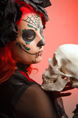 beautiful model with halloween make up sugar skull.,