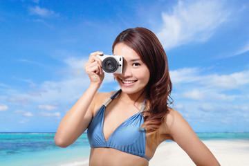 Bikini woman with camera