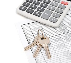 Calculator and keys on the documents.