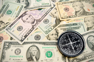 Compass on dollars.