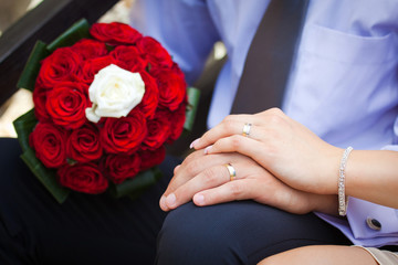 Bride and groom showing the engagement rings