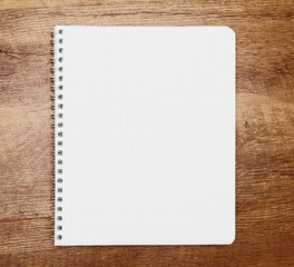Notebook on wooden background.
