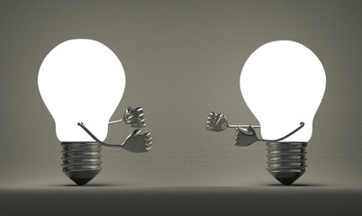 Glowing light bulbs fighting with fists on gray