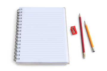 Blank notepad with pencil and  sharpener on white background