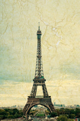 famous Eiffel Tower in Paris, France. Grunge style photo.