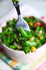 Salad with green beans, ham and  corn in bowl,