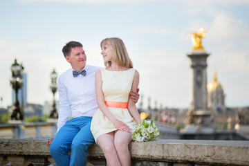 Newly-wed couple on Alexandre III bridge in Paris