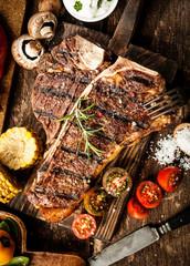 Grilled t-bone steak in a rustic kitchen