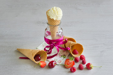 Ice cream in the cone with berries