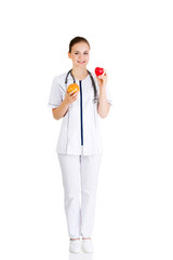 Doctor holding healthy grapefruit and red heart.
