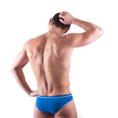 Young man wearing swimsuit from behind isolated over white backg