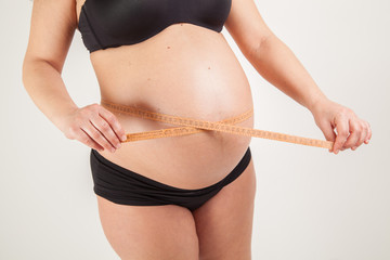 Belly of pregnant woman, measuring belly
