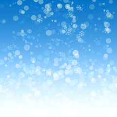 Abstract blue background with effect a bokeh and snowflakes