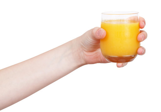 hand holds glass with orange juice isolated