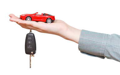 new red car with key on hand isolated