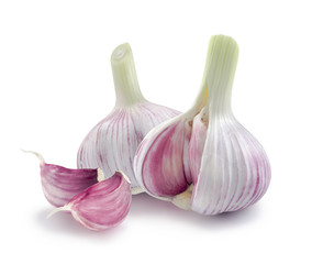 Two young garlic heads and cloves isolated on white background
